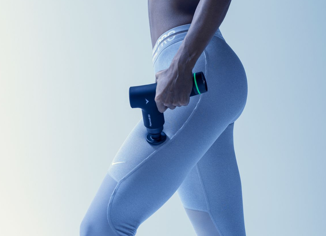 Image of person using the Hypervolt GO product on their middle thigh