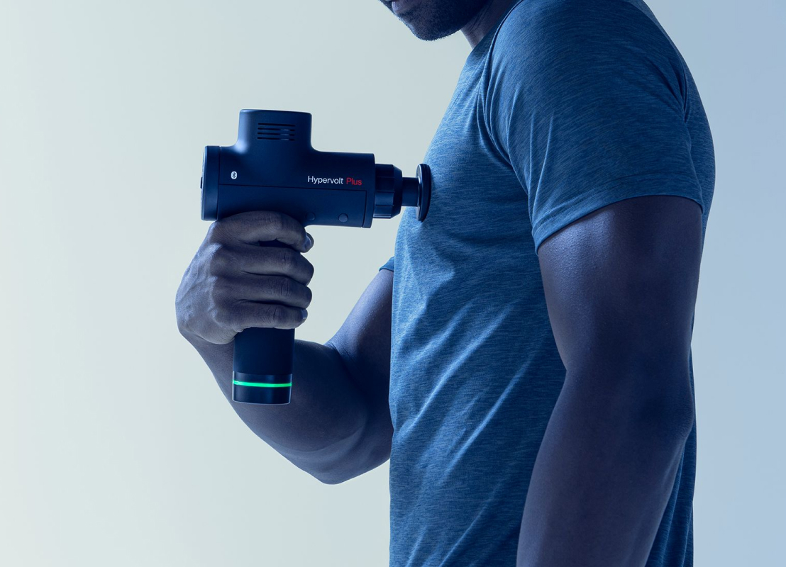 Image of person using the Hypervolt Plus on their left pectoral